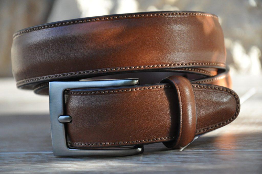 An image of a brown belt which young professionals need